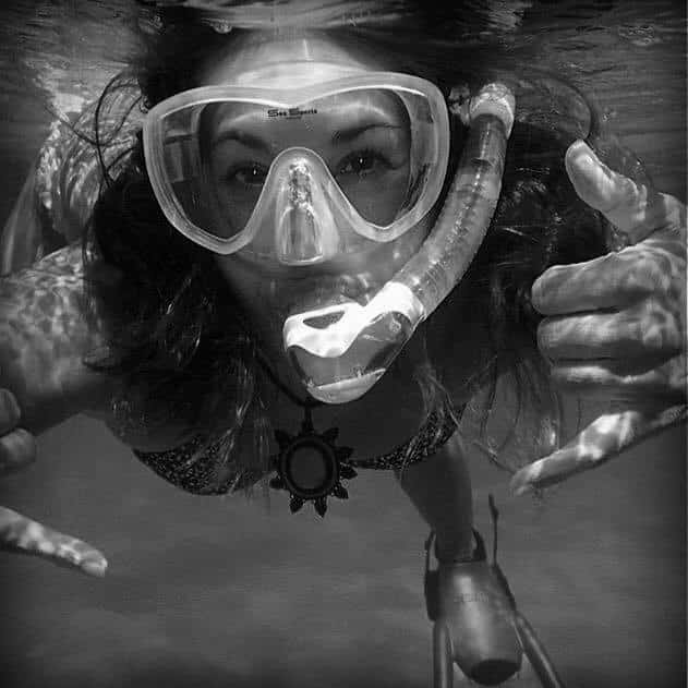 black and white photo of snorkeler facing the camera